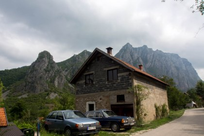 This photo sums up bosnia pretty well, old mercs,freshly built houses and mountains