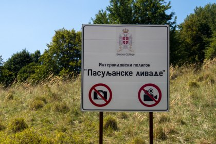 The reason for this sign was obvious after we cycled around the corner to see a barracks full of tanks