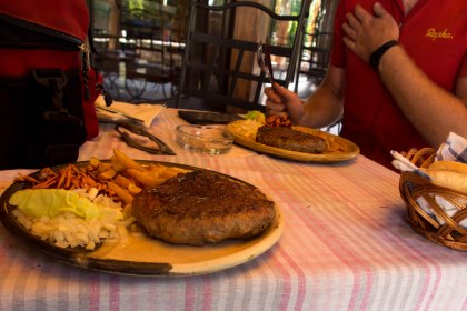 """After lugging our bikes over an old tractor road we stopped at the first restaurant we found. We ordered """"something good and were presented with the biggest burgers we've ever seen. The timing couldn't have been better"""