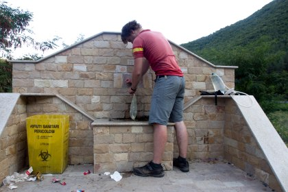 Grabbing water from on of the many fountains on the roadside in the mountains