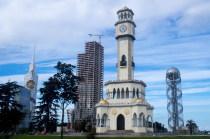 Batumi is a seaside city full of strange and unfinieshed skyscapers. That's a gold ferriswheel pocking out of one of them