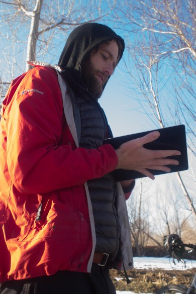 Hugo heating up his iPad after it says it's too cold to work