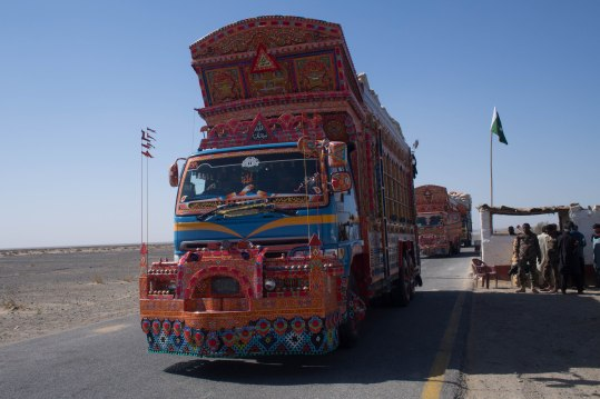 Trucks passing through a police checkpoint