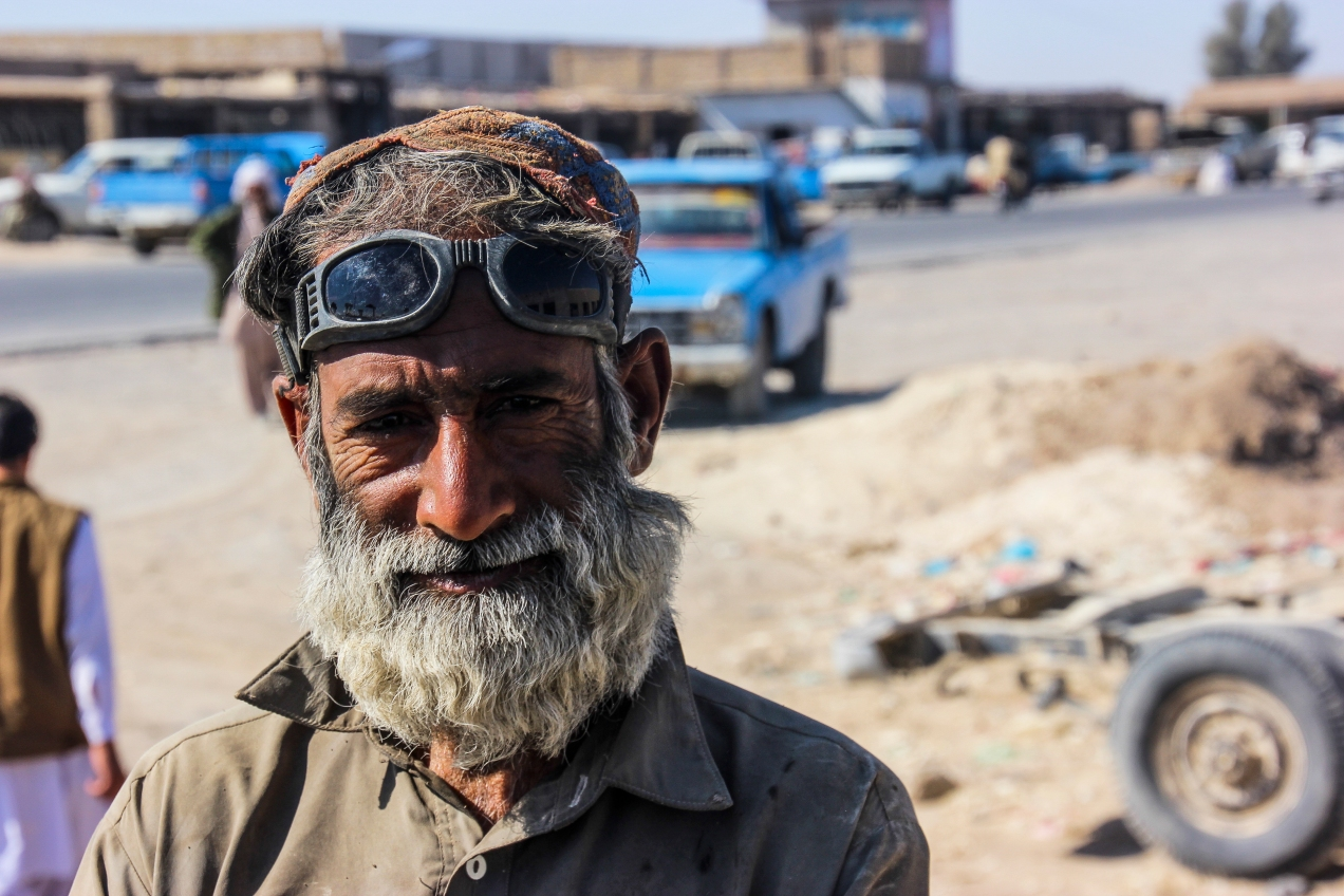 "A local welder in one of many, small and dusty ""Mad Max"" villages in the desolate province of Baluchistan."