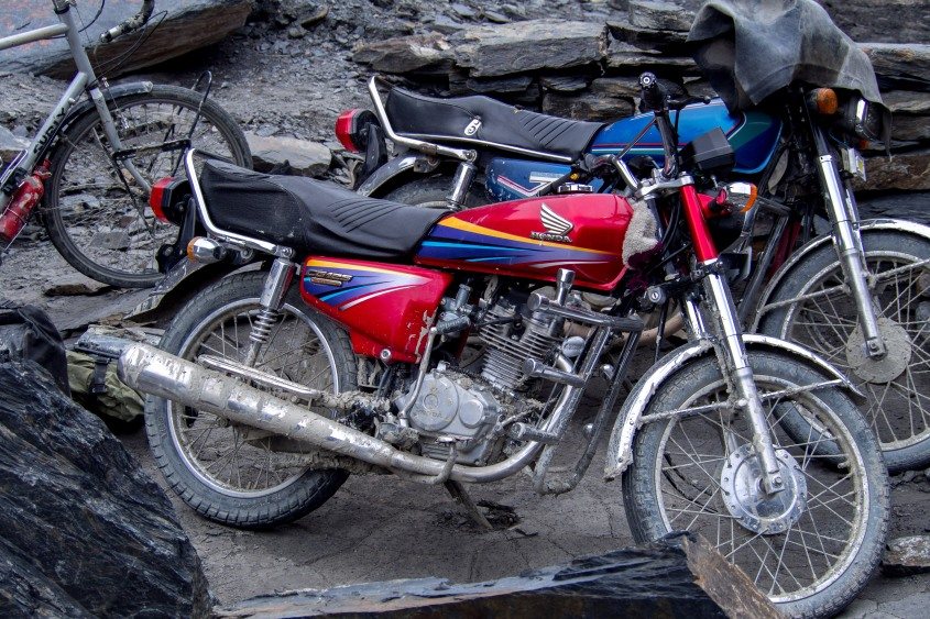 The Pakistanis seem to come out of the womb on these motorbikes