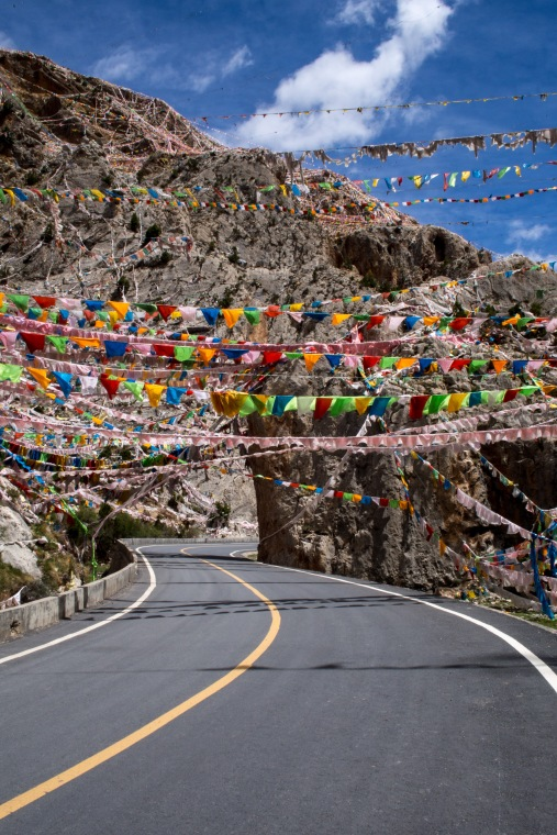Prayer Flags sending out good fortune to all sentient being. They are a pretty common sight all across the plateau.