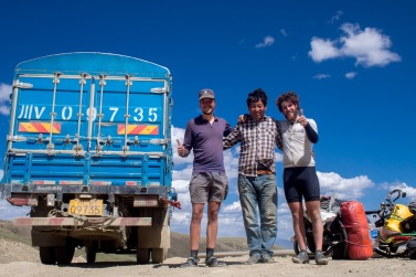 Andre and I joined this Tibetan for a lift up the pass