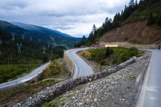 At the higher altitudes, vehicles have reduced horspower because of the thinner air. So the roads can't be too steep. This results in beatiful switchbacks winding their way over the pass.